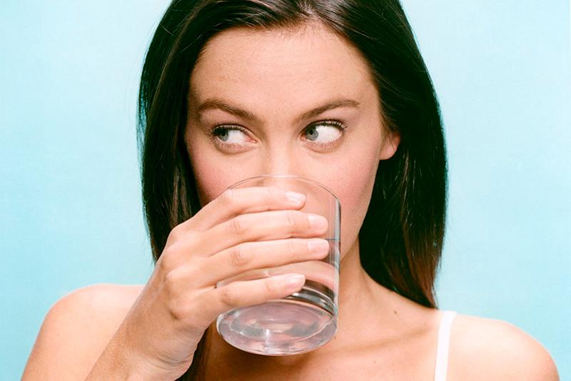 woman-drinking-glass-water