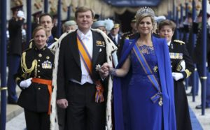 Dutch King Willem-Alexander and his wife Queen Maxima walk after attending a religious ceremony at the Nieuwe Kerk church in Amsterdam