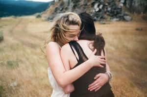 hugging friends