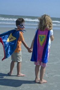super heroes at the beach
