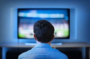 Jersey City, New Jersey, Man watching tv in living room