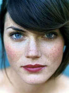 dark hair blue eyes woman