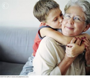 Loving Boy Kissing Grandmother