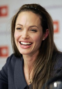 Angelina Jolie smiles during a news conference in Washington